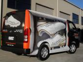 Full van wrap combination matt black vinyl and digital printed graphics to create a moving shoe box!
